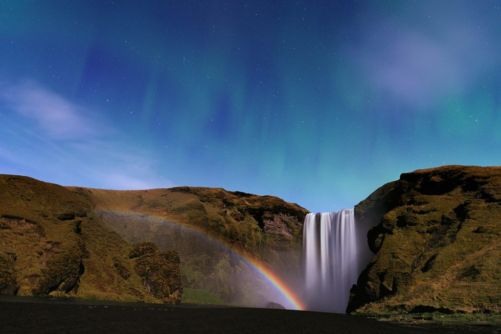 moonbow near a waterfall