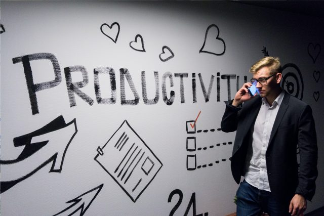 A man thinking about productivity written on the board.