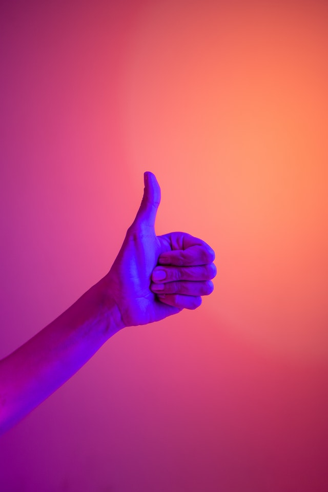 a thumbs up hand as a non-verbal communication cue