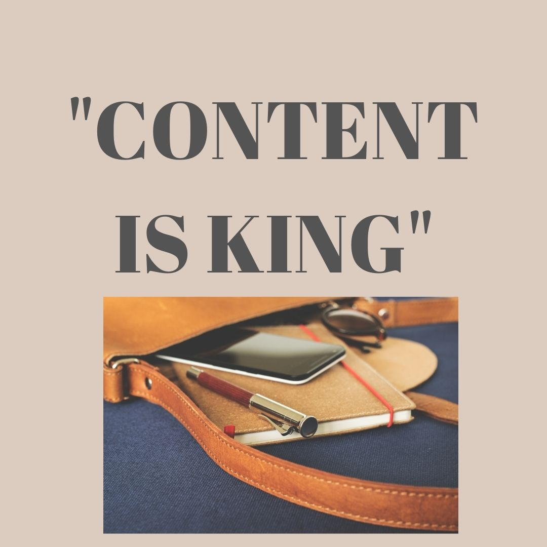 content is king- written above a notepad