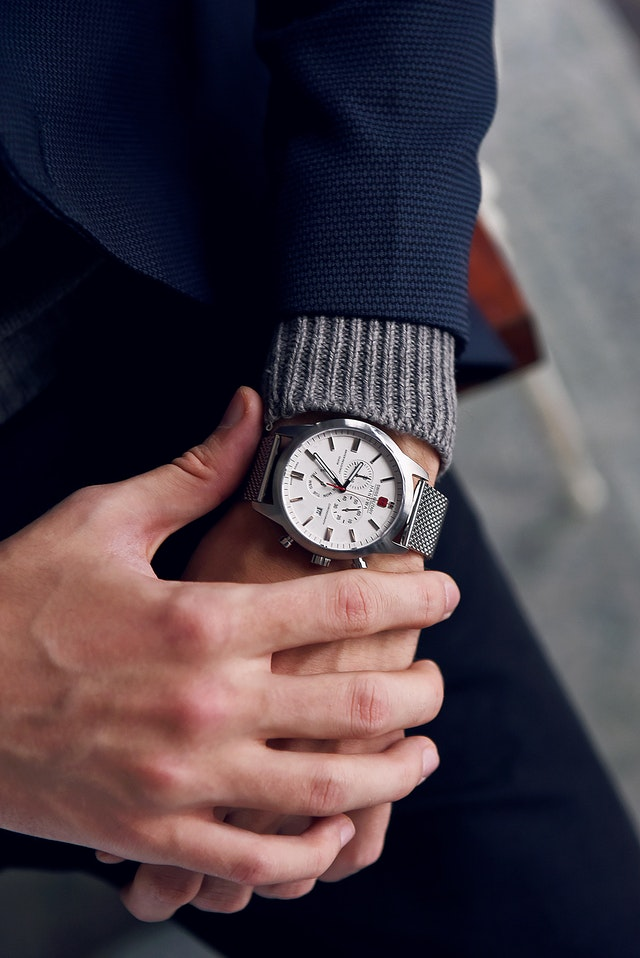 Person looking at watch showing importance of punctuality